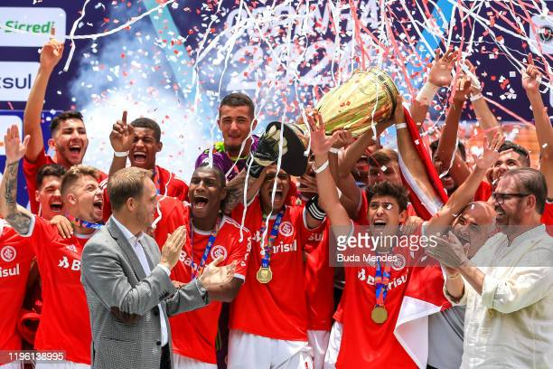 Players of Internacional celebrates the title after a match between Internacional and Gremio as part of Copa Sao Paulo de Futebol Junior Final at...