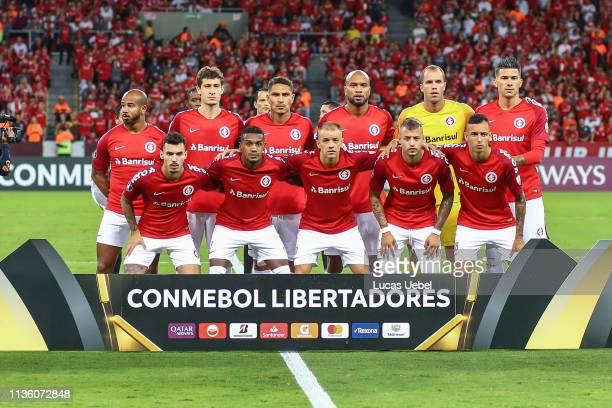 Players of Internacional pose for a photo before the match between Internacional v Palestino as part of Copa CONMEBOL Libertadores 2019, at Beira-Rio...