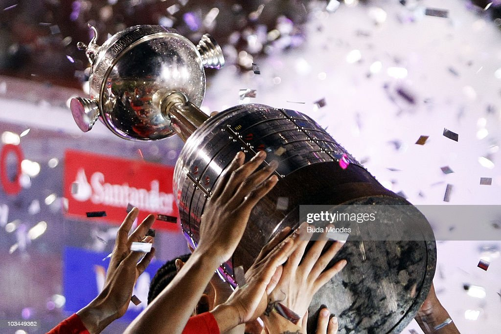 Players of Internacional raise up the championship trophy after a final match against Chivas as part of the 2010 Copa Santander Libertadores at Beira Rio Stadium on August 18, 2010 in Porto Alegre, Brazil.