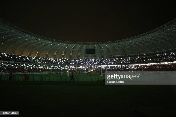 Players of Internacional waits for the light back after a blackout at Estadio Beira Rio during the match between Internacional and Coritiba as part...