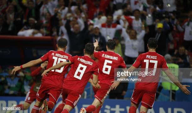 Players of Iran celebrate after scoring a goal despite the offside flag has been raised during the 2018 FIFA World Cup Russia Group B match between...