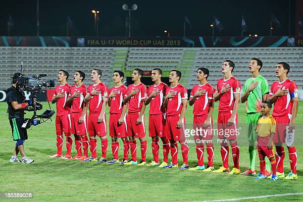 Players of Iran sing their national anthem prior to the FIFA U17 World Cup UAE 2013 Group E match between Iran and Argentina at Al Rashid Stadium on...