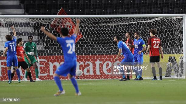 Players of Iran's Esteghlal FC celebrate after Qatar's AlRayyan SC scored an own goal during their Asian Champions League football match at Jassim...