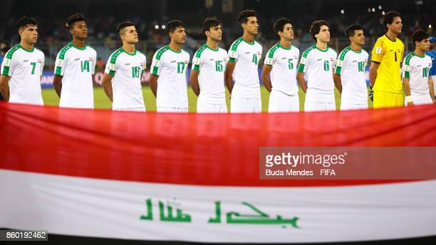 Players of Iraq line up for the National Anthems ahead of the FIFA U17 World Cup India 2017 group F match between Iraq and Chile at Vivekananda Yuba...