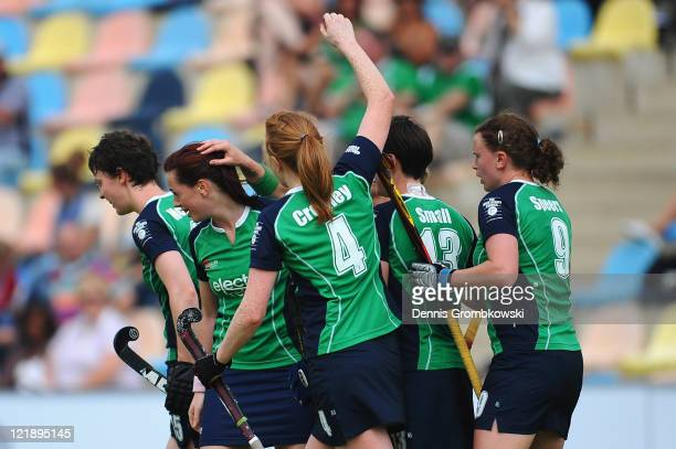 Players of Ireland celebrate after scoring their team's opening goal during the Women´s EuroHockey Championships 2011 Pool B match between Ireland...