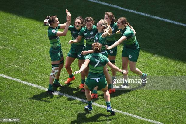Players of Ireland celebrates after defeating Canada in the Trophy Semifinal on day two of the HSBC Women's Rugby Sevens Kitakyushu at Mikuni World...
