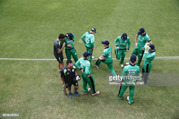 Players of Ireland prepare to take the field for their 2nd innings during the ICC U19 Cricket World Cup match between Sri Lanka and Ireland at Cobham...