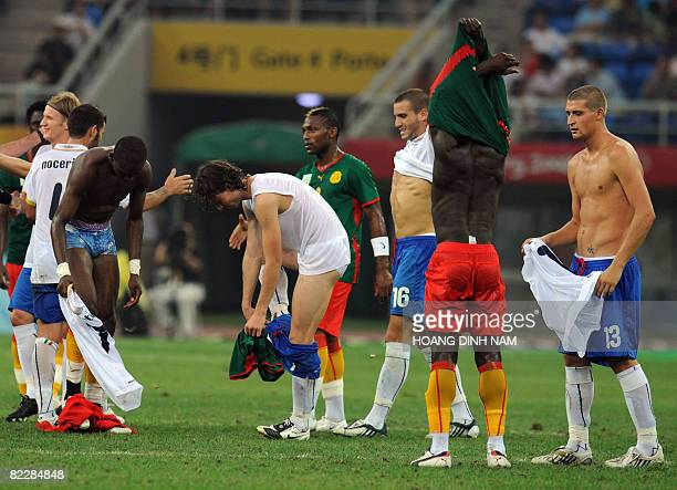 Players of Italy and Cameroon exchange their shirts and shorts at the end of the 2008 Beijing Olympic Games first round group D men's football match...