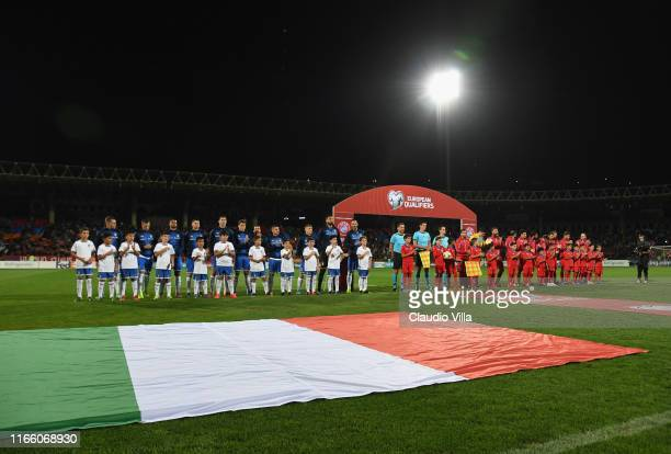 Players of Italy and players of Armenia sing the national anthem ahead of the UEFA Euro 2020 qualifier between Armenia and Italy at Republican...