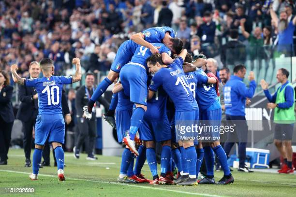 Players of Italy celebrate after scoring a goal during the 2020 UEFA European Championships group J qualifying match between Italy and Bosnia and...