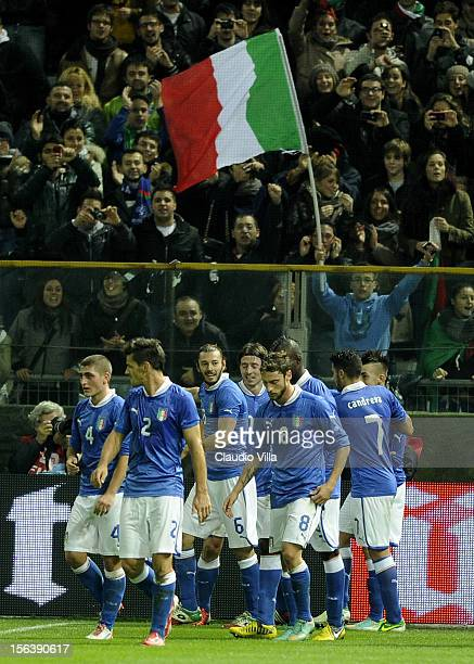 Players of Italy celebrate after their team-mate Stephan El Shaarawy scored the opening goal during the international friendly match between Italy...