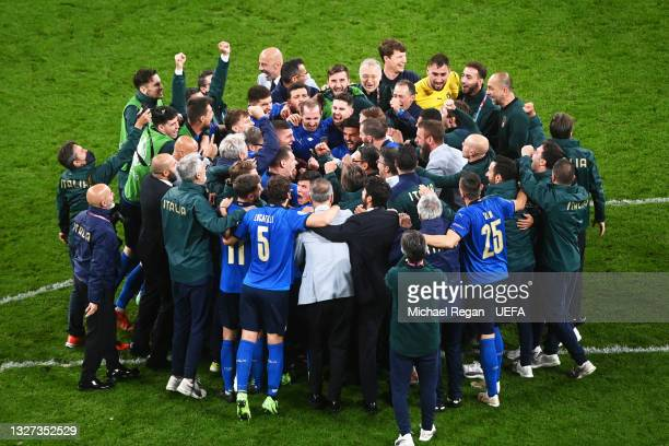 Players of Italy celebrate after victory in the UEFA Euro 2020 Championship Semi-final match between Italy and Spain at Wembley Stadium on July 06,...