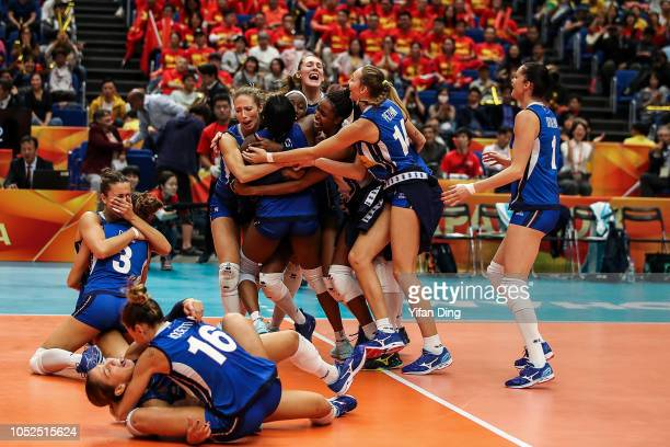 Players of Italy celebrate after winning match point during the FIVB Women's World Championship semi final between China and Italy at Yokohama Arena...