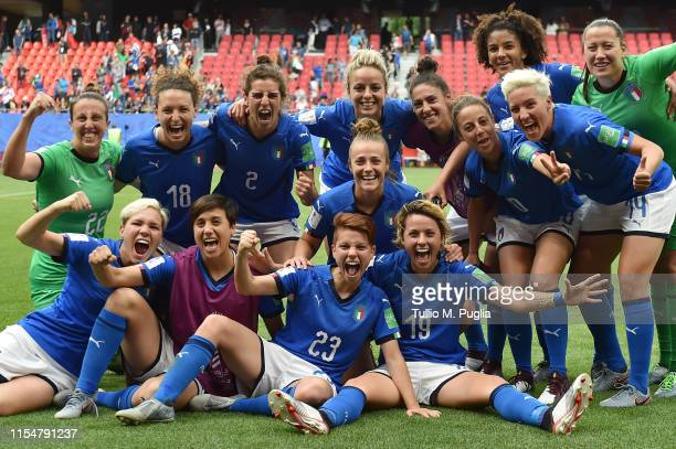Players of Italy celebrate after winning the 2019 FIFA Women's World Cup France group C match between Australia and Italy at Stade du Hainaut on June...