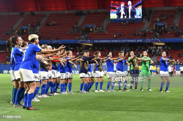Players of Italy celebrate after winning the Group C during the 2019 FIFA Women's World Cup France group C match between Italy and Brazil at Stade du...