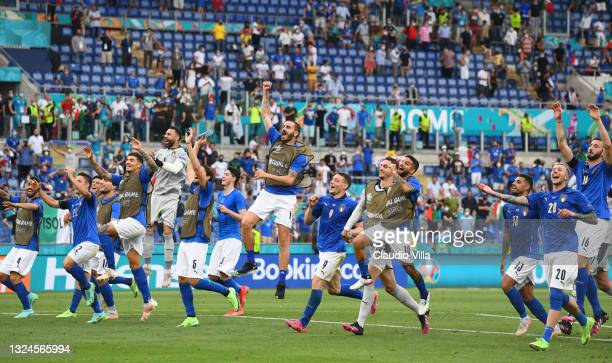 Players of Italy celebrate at the end of the UEFA Euro 2020 Championship Group A match between Italy and Wales at Olimpico Stadium on June 20, 2021...