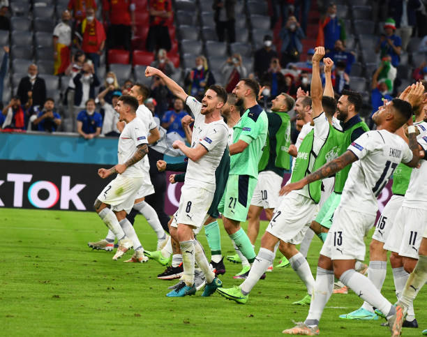 Players of Italy celebrate at the end of the UEFA Euro 2020 Championship Quarter-final match between Belgium and Italy at Football Arena Munich on...