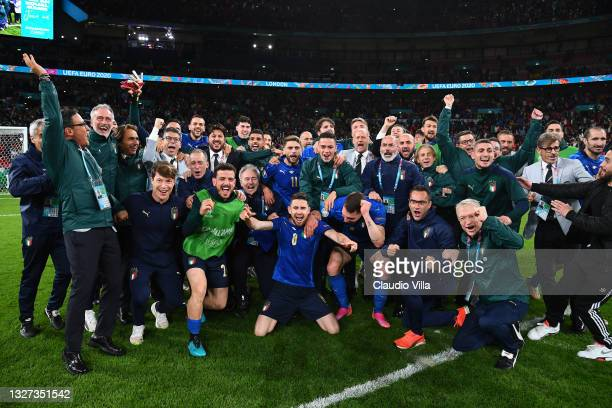 Players of Italy celebrate following their team's victory in the penalty shoot out after the UEFA Euro 2020 Championship Semi-final match between...
