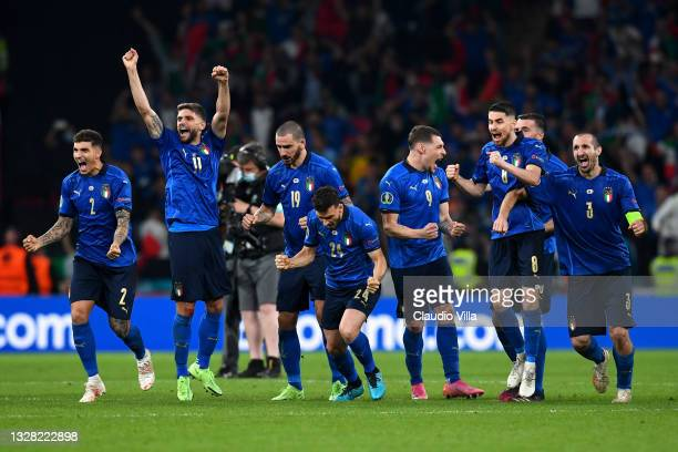 Players of Italy celebrate following their team's victory in the penalty shoot out during the UEFA Euro 2020 Championship Final between Italy and...