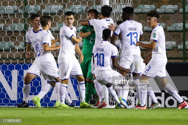 Players of Italy celebrate the stop of goalkeeper Marco Molla during the FIFA U17 Men's World Cup Brazil 2019 group F match between Mexico and Italy...