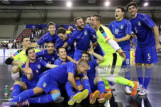 Players of Italy celebrate the victory after during the FIFA Futsal playoff match between Italy and Hungaryon April 13 2016 in Prato Italy