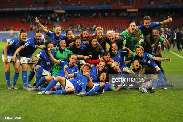 Players of Italy celebrate their entry of the Rouund 16 during the 2019 FIFA Women's World Cup France group C match between Italy and Brazil at Stade...