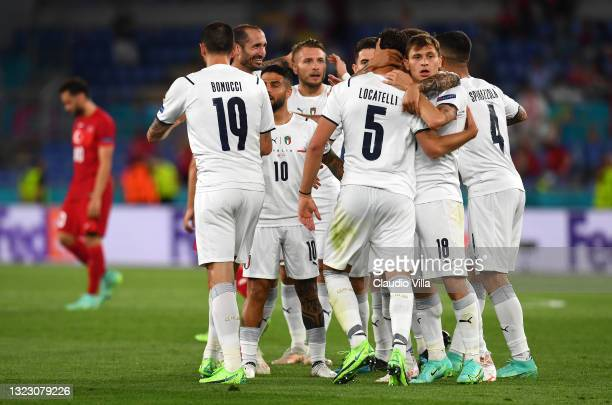 Players of Italy celebrate their side's first goal, an own goal by Merih Demiral of Turkey during the UEFA Euro 2020 Championship Group A match...