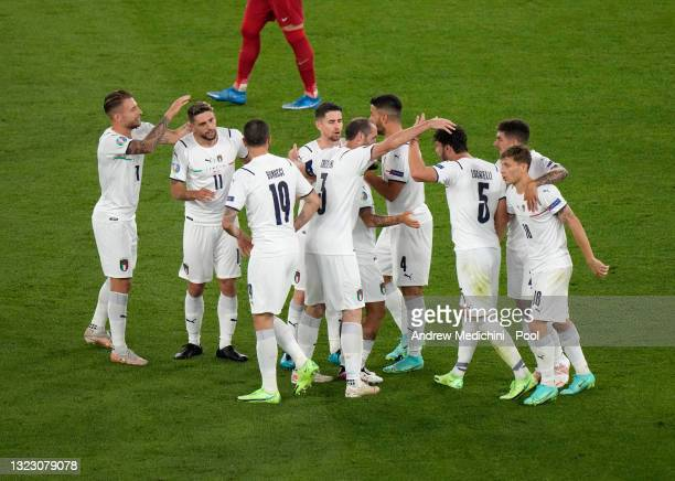 Players of Italy celebrate their side's first goal scored by Merih Demiral of Turkey during the UEFA Euro 2020 Championship Group A match between...