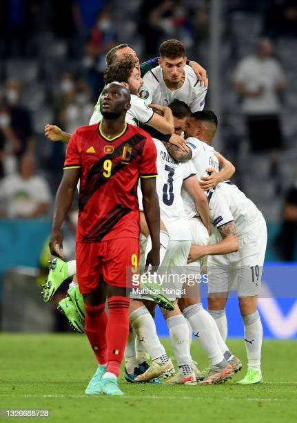 Players of Italy celebrate their side's victory as Romelu Lukaku of Belgium looks dejected after the UEFA Euro 2020 Championship Quarter-final match...
