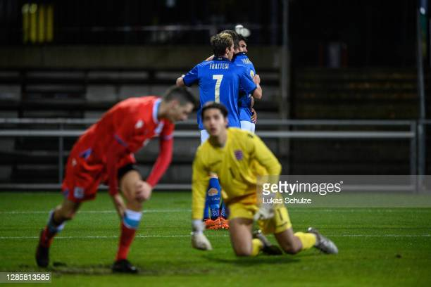 Players of Italy celebrate their team's third goal scored by Andrea Pinamonti of Italy during the UEFA Euro Under 21 Qualifier match between...