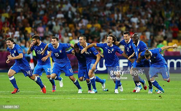 Players of Italy celebrate victory after the penalty shoot out during the UEFA EURO 2012 quarter final match between England and Italy at The Olympic...