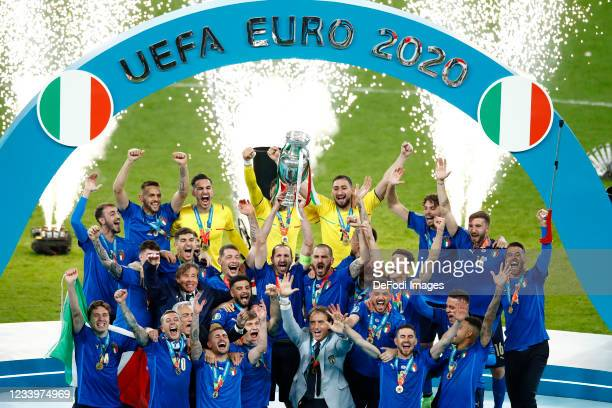 Players of Italy celebrate with the trophy after winning the UEFA Euro 2020 Championship Final between Italy and England at Wembley Stadium on July...