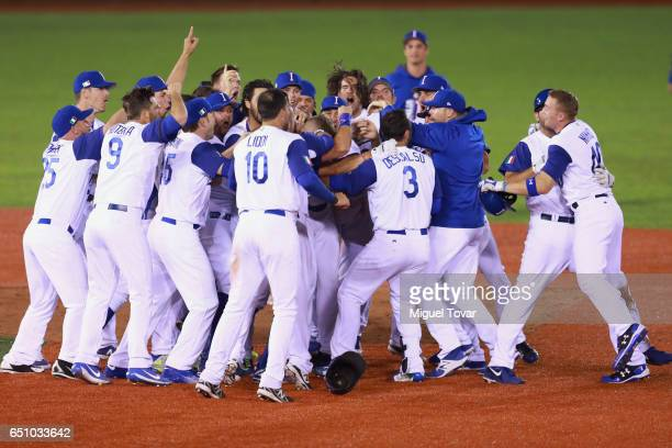 Players of Italy celebrates after defeating Mexico during the World Baseball Classic Pool D Game 1 between Italy and Mexico at Panamericano Stadium...