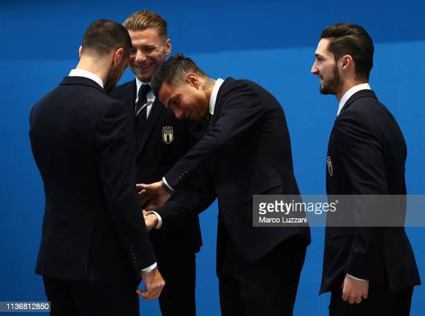 players of Italy get dressed ahead of the Italy team photo with the new Armani suit at Centro Tecnico Federale di Coverciano on March 19 2019 in...