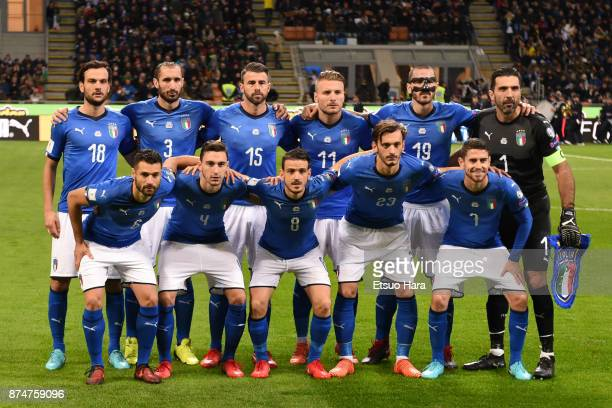 Players of Italy line up for team photos prior to the FIFA 2018 World Cup Qualifier PlayOff Second Leg between Italy and Sweden at San Siro Stadium...