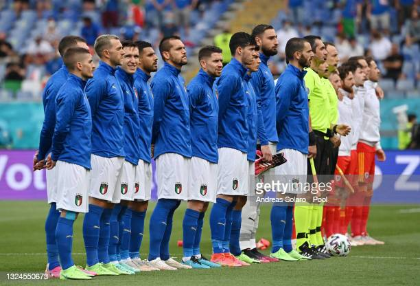 Players of Italy line up for the national anthem prior to the UEFA Euro 2020 Championship Group A match between Italy and Wales at Olimpico Stadium...