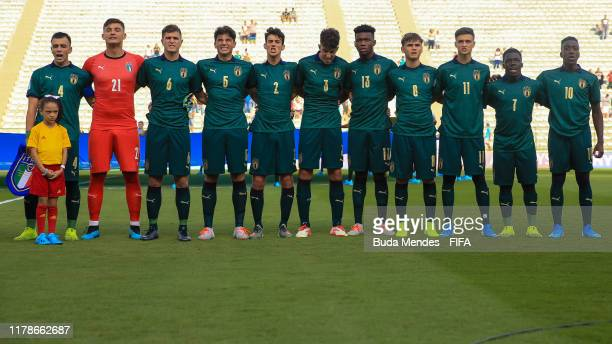 Players of Italy line up for the National Anthems ahead the FIFA U-17 Men's World Cup Brazil 2019 group F match between Solomon Islands and Italy at...