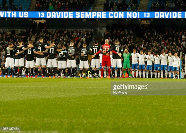 Players of Italy observe a minutes silence in memory of Davide Astori prior to the International friendly match between Italy and Argentina at Etihad...