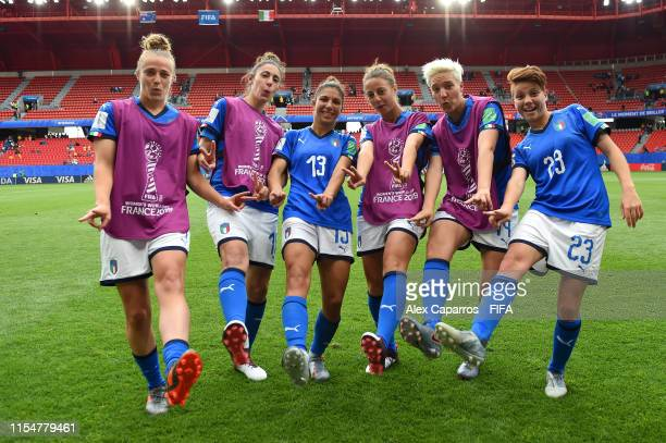 Players of Italy pose for a photograph as they celebrate victory in the 2019 FIFA Women's World Cup France group C match between Australia and Italy...
