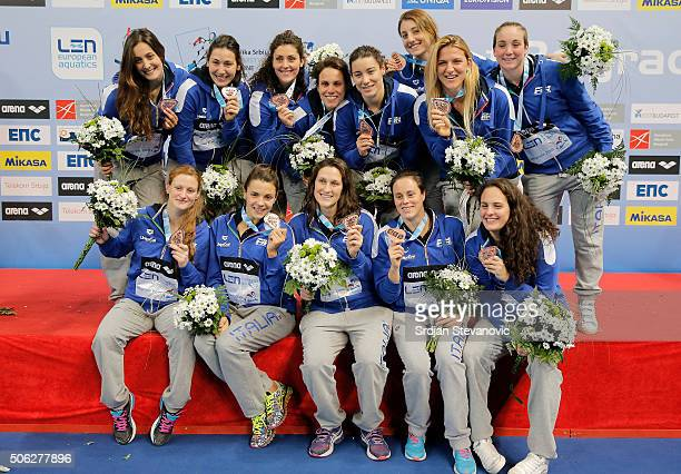 Players of Italy pose with the Bronze medal during the Women's Medal ceremony at the Waterpolo European Championships in Belgrade Kombank Arena on...