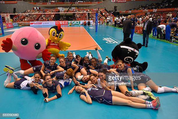 Players of Italy poses for photographs after winning the Women's World Olympic Qualification game between Italy and Kazakhstan at Tokyo Metropolitan...
