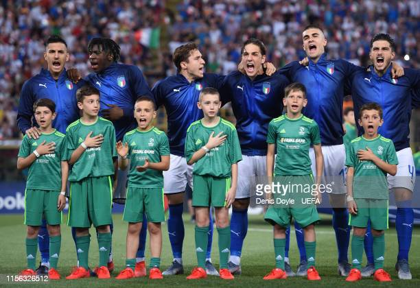 Players of Italy sign their national anthem prior to the 2019 UEFA U21 Group A match between Italy and Spain at Renato Dall'Ara stadium on June 16...