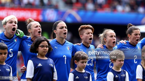 Players of Italy sing the national anthem prior to the 2019 FIFA Women's World Cup France group C match between Australia and Italy at Stade du...