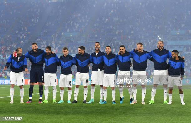 Players of Italy sing the national anthem prior to the UEFA Euro 2020 Championship Group A match between Turkey and Italy at the Stadio Olimpico on...