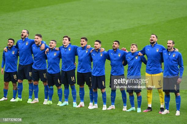 Players of Italy sing the national anthem prior to the UEFA Euro 2020 Championship Semi-final match between Italy and Spain at Wembley Stadium on...
