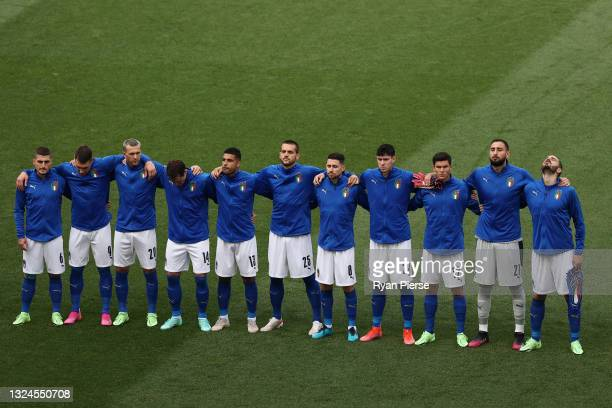 Players of Italy stand for the national anthem prior to the UEFA Euro 2020 Championship Group A match between Italy and Wales at Olimpico Stadium on...