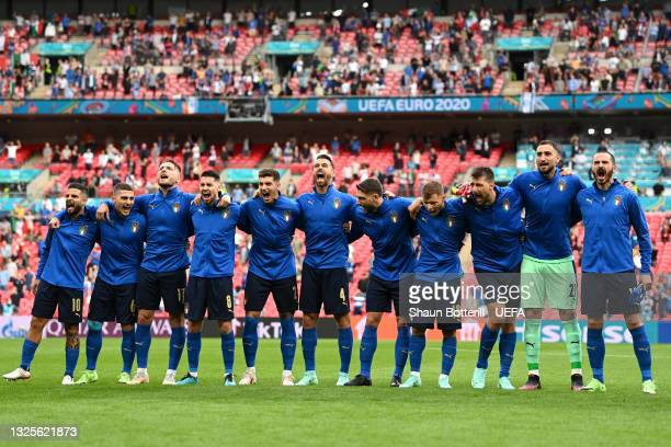 Players of Italy stand for the national anthem prior to the UEFA Euro 2020 Championship Round of 16 match between Italy and Austria at Wembley...