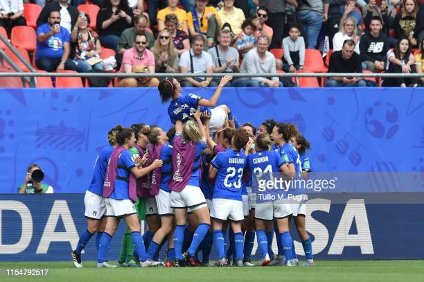 Players of Italy throw Barbara Bonansea in the air in celebration of winning the 2019 FIFA Women's World Cup France group C match between Australia...