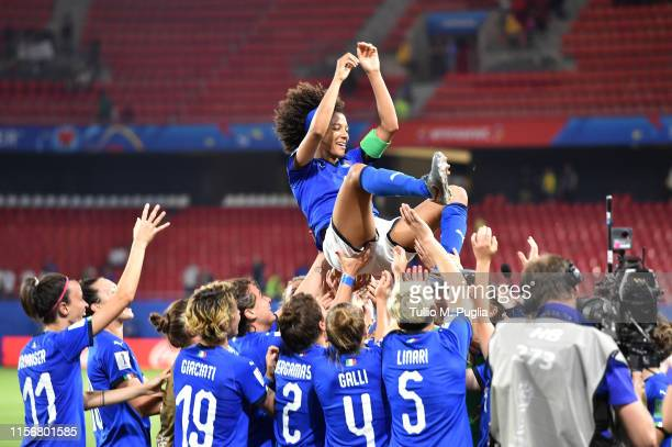 Players of Italy throw Sara Gama in the air in celebration of winning the Group C during the 2019 FIFA Women's World Cup France group C match between...