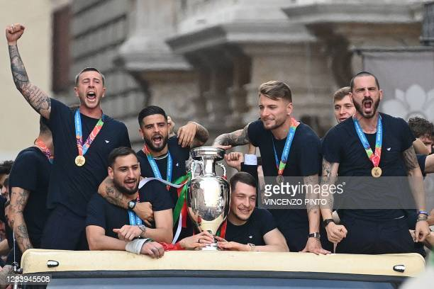 Players of Italy's national football team parade with the UEFA EURO 2020 trophy on a double decker bus in Rome on July 12 a day after Italy won the...